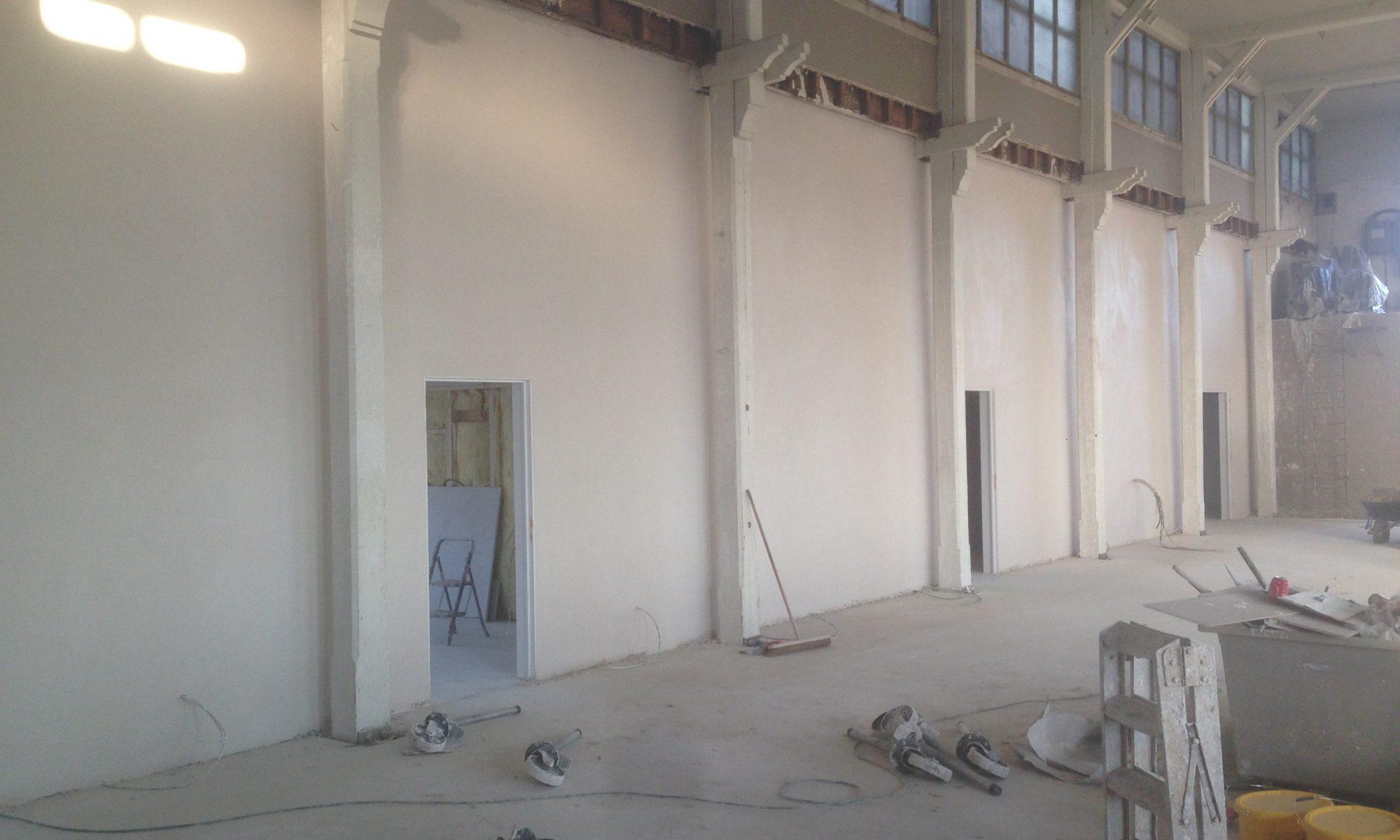 muur verwarming afgewerkt met pleisterwerk